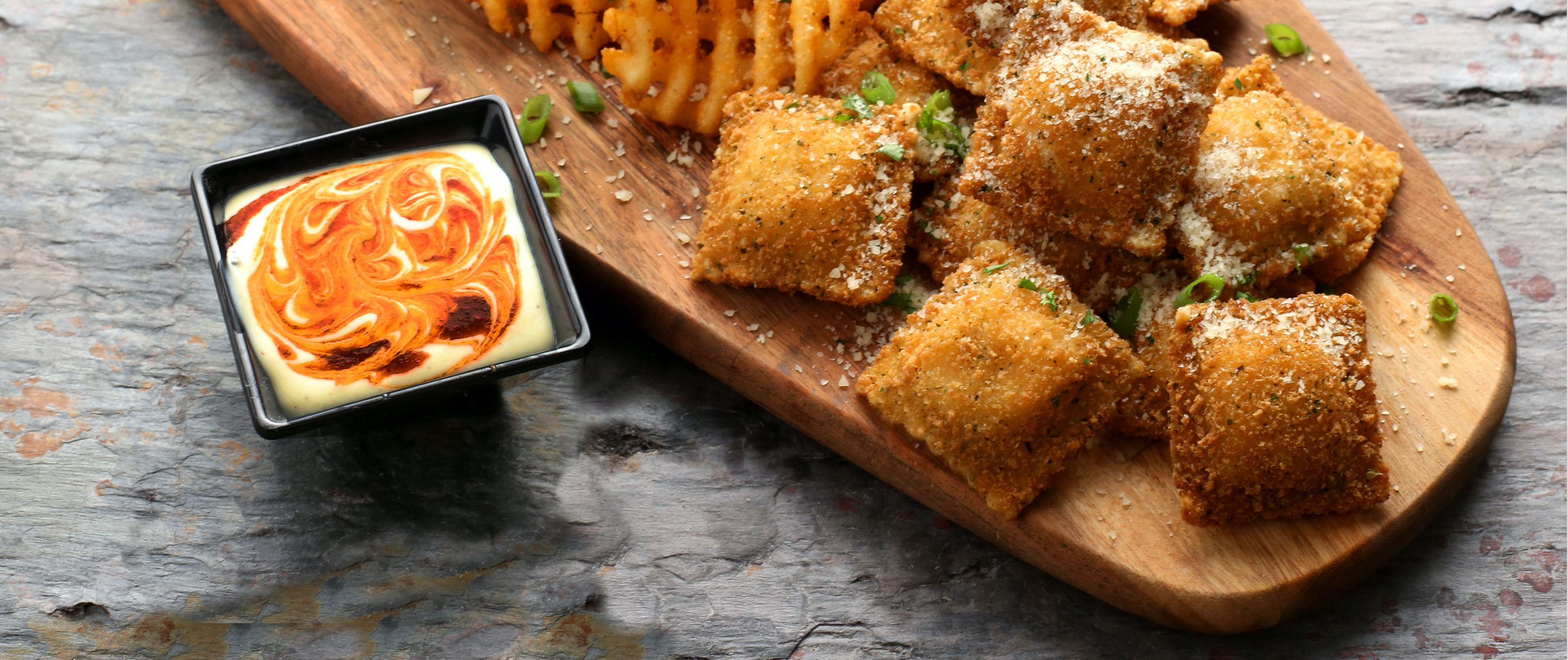 A plate of toasted appetizers with Parmesan cheese sprinkled on top.