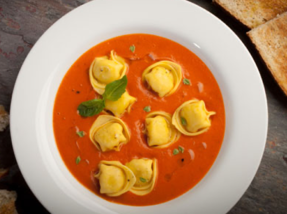 Tortellini in a bowl of tomato bisque